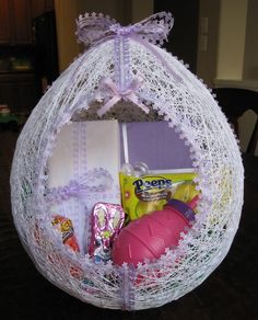 Egg Shaped Easter Basket Made from String. Create this fun and colorful Easter baskets with your kids to hold their gifts and collect their treasures during Easter egg hunts. http://hative.com/cute-easter-craft-ideas-for-kids/