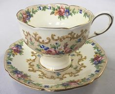 """Paragon Minuet Teacup and Saucer, Corset style Lovely vintage corset Paragon Set Double warrant Excellent condition No chips cracks or crazing Gold gilt Measures: Cup opening 3.3"""" Including handle 4.3"""" Saucer 5.3"""" *Combined Shipping is Available for Multiple Purchases* GIFT"""