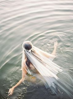 Model willing to get in the water - yes!  {veil by Emily Riggs Bridal | photo by Erich McVey/Amy McVey}
