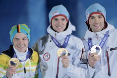 DAY 12:  (L-R) Bronze medalist Fabian Riessle of Germany, gold medalist Joergen Graabak of Norway and silver medalist Magnus Hovdal Moan of Norway during the medal ceremony for the Nordic Combined Men's Individual Large Hill/10km Cross Country http://sports.yahoo.com/olympics
