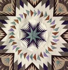 Jenny's Glacier Star quilt.   Machine quilted by Kathleen Crabtree.  Pattern by Judy Niemeyer.