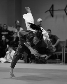 'Uchi Mata'  Judo Throw  Photographer: Jonathan Beck -- One of my goals is to have a picture taken of me and Im the girl in the dark gi. it will happen.