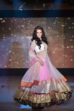 Neha Dhupia modeling an Indian wedding lehnga by Manish Malhotra. Click through for more.