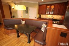 Cool breakfast seating built rght into the other side of the kitchen workspace.  Must save a lot of space!