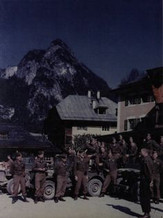 Troopers of the 101st and their jeeps on a street in Berchtesgaden, 1945