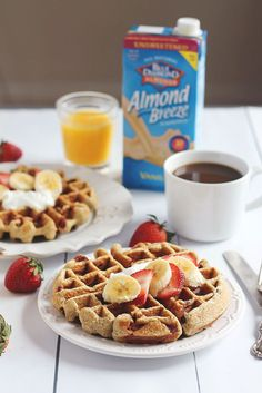 Healthy Strawberry Banana Oatmeal Greek Yogurt Waffles packed with protein, fiber and nutrition. Just toss everything in the blender (besides the strawberries) to make the batter!