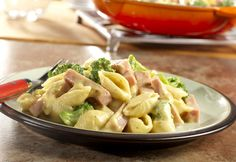 A mustard-spiked cheese sauce cloaks ham and broccoli, and is stirred into pasta. It's a recipe for a quick-cooking family favorite!