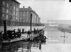A diver at work unloading a sunken barge loaded with 55 tons of Manganite which sank in the Limehouse Cut - a canal connecting the River Lea with the Thames at Poplar. London Pictures, London Photos, Old Pictures, Old Photos, London History, British History, Vintage London, Old London, East End London