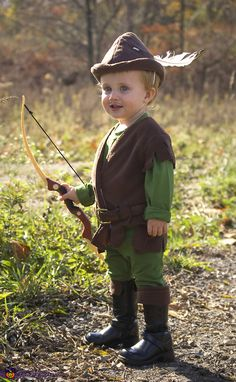 Robin Hood Costume - brown fleece tunic, hat, and boot tops, green shirt and pants, belt, boots, bow and arrow, and a feather in his cap