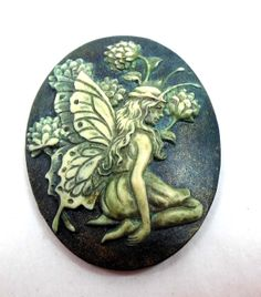 Alcohol ink patina over resin cameo.
