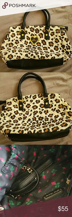 Vintage Betsey Johnson Leopard Neoprene Handbag This rare handbag is medium sized and made of neoprene fabric! It has a beautiful enamel logo heart on front and comes with extra crossbody strap. Only used 3 times so in excellent condition! Betsey Johnson Bags Satchels