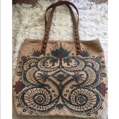 free people glided age tote sold out on the website! printed with cool boho design with studded synthetic leather handles. plus a easy access pouch on a rope. 55% jute 45% cotton excellent condition no stains in it. no trade no pp firm price. Free People Bags Totes