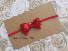 Simple but cute red sequin bow headband. Adds  spice to any Christmas outfit.
