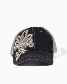 A symbol of style: an embellished insignia lands on this classic cap. This denim and mesh-backed baseball-style hat is fashioned with a rhinestone patch and adjustable tab.