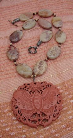 Exquisite Designer Necklace with Fossil Coral from Indonesia and Resin LUNA MOTH