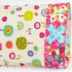 Fabric: Fly Away by Amy Schimler for Robert Kaufman Fabrics. Pillowcase Pattern 24. Free download here: http://www.allpeoplequilt.com/millionpillowcases/freepatterns/index.html