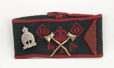 WLA 2-year armband with half-diamond for additional 6 months service. Timber Corps badge, and crossed axes. This appears to a rare, cast metal badge.