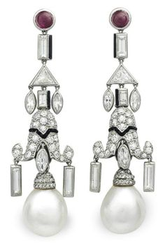 A PAIR OF ART DECO NATURAL PEARL, DIAMOND AND MULTI-GEM EAR PENDANTS, BY CARTIER. Each suspending a slightly baroque drop-shaped natural pearl from a single-cut diamond and calibré-cut onyx pagoda-shaped plaque, suspending variously-cut diamonds trimmed with black enamel, to the cabochon ruby surmount, circa 1925, with French assay marks for platinum. Signed Cartier, numbered. #Cartier #ArtDeco #earrings