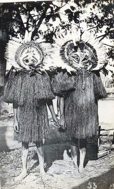 Two Papuan Gulf men dressed for ceremony in full body masks, British New Guinea. Real photo postcard, c 1910's, printed on Kodak Austral stock (not postally used)