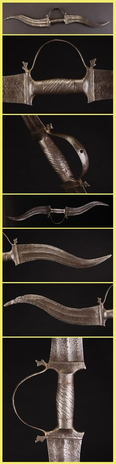 """Indian haladie, 19th century or earlier, 26"""" overall with two 10 1/2"""" blades, from the Rajput warriors of India. It is all steel forged, including the handle, with two double edged blades and a knuckle guard. The knuckle guard would have had a third small straight blade sticking out, but it is missing with only an attachment hole remaining."""