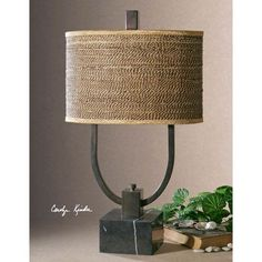 Stabina table lamp a 'strong' contemporary design with a rustic bronze U-shape metal body and a black marble base. The oval drum shade is a brown and tan woven rattan with decorative trim. Rustic Table Lamps, Metal Table Lamps, Black Table Lamps, Lamp Table, Black Chairs, High Chairs, Desk Lamp, Rustic Decor, Tuscan Decorating