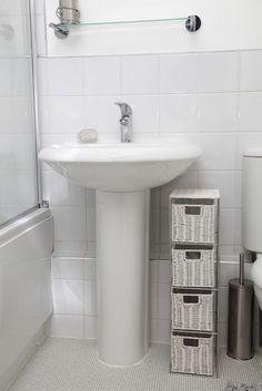 White Pedestal Sink With Nearby Wicker Storage ~ http://walkinshowers.org/best-pedestal-sink-reviews.html
