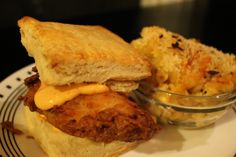 Fried chicken and biscuits with sriracha mayo and baked macaroni and cheese