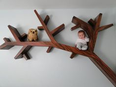 Tree Branch Bookcase by Chad P. Hunt Fine Art Studio.  I love this bookcase for the children's room.  What a cute baby!