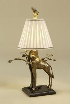 Whimsical giraffe table lamp. made of brass with a granite base.