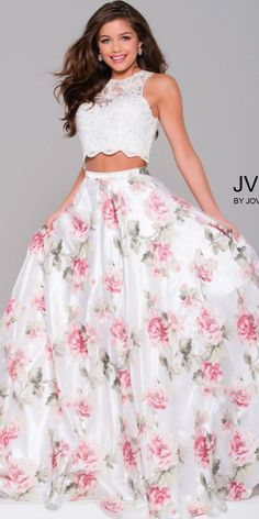 Get ready to flounce and flirt in the Floral Lace and Organza Two Piece Prom Dress from JVN by Jovani. This sweet and playful two piece features a white lace crop top and a floral print A-line organza skirt. Floral Skirt Outfits, Floral Prom Dresses, Prom Dresses Two Piece, Indian Gowns Dresses, Cute Prom Dresses, Two Piece Dress, Pretty Dresses, Beautiful Dresses, Evening Dresses