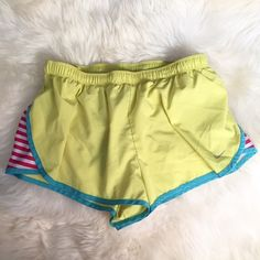 Nike Neon Yellow Dri-Fit Running Shorts In excellent condition on outside, inside underwear lining has a few minor holes but not noticeable when worn. Neon yellow with blue piping on side and bottom and pink/white stripes on side. Drawstring waist. Inside has yellow underwear to wear so not showing. ❌NO TRADES OR PAYPAL❌ Nike Shorts