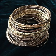Instant Vintage Goldtone Metal Bracelets Two inches of bracelets in Goldtone metal accumulated over the years. Jewelry Bracelets