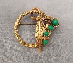 Vintage antiqued gold-tone circle pin leaves with emerald green lucite flowers #Unsigned