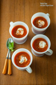 Tomato Soup with Basil Yogurt Cream by splendidtable: What's not to love about a tomato soup spiked with orange zest, spices, sweet onions, and garlic? Add beans, browned onions, and top with sliced avocado, a little sour cream and a generous squeeze of lime for a work night encore.  #Soup #Tomato #Yogurt_Cream #Basil