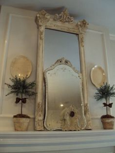 big mirror and smaller mirror on the mantle.