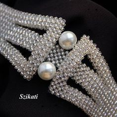 FREE SHIPPING!!!  This elegant one-of-a-kind beadwoven bracelet has an absolute unique, eye-catching shape and design with a wonderful combination of pearl and sparkling silver-lined translucent seed beads.  Length: 7,8 inches (19,5 cm) Width: 1 inch (2,5 cm) - 1,6 inches (4 cm) in the middle Closure: magnetic slide lock clasp  Materials: - 10 mm pearl - silver lined translucent Czech seed bead  Technique: 3D Right Angle Weave (3D RAW)  The bracelet is my own design!  This handcrafted piece…