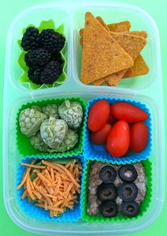 Taco Fiesta: blackberries, sweet potato chips, grape tomatoes, sliced black olives in taco meat, lettuce and shredded cheese and guacamole frozen into little grape shapes that should thaw by lunchtime. Vegan Lunch Box, Bento Box Lunch, Box Lunches, School Lunches, Lunch Boxes, Vegan Foods, Vegan Recipes, Snack Recipes, Veggie Cheese