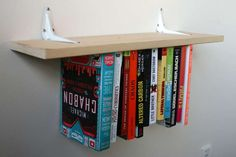 The inverted bookshelf comes from Instructables user fungus amungus, who managed to apparently defy gravity. The secret to this design is a clever placement of elastic, holding each book tied to the shelf.