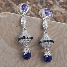 Displaying a fascinating appeal, this pair of Lapis Lazuli earrings  are designed just for you. Laced with simulated blue diamonds and set in platinum bond brass, these dangling delights feature Lazuli with deep blue tone. A perfect finery to make you look sophisticate and fashionable at the same time!  Free Shipping Gift Box