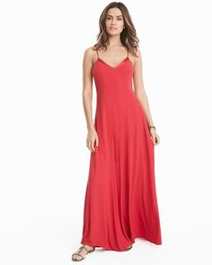 "Our maxi slip dress is one and done in 30 seconds flat. We added a flirty tie-up detail on the back you can adjust to your liking—if you're petite, we've tailored the waistline and shortened the hem for a proportional fit. Slip on sandals, a long necklace and go.  Tie-up slip maxi dress in red coral Satin trim along V-neck Adjustable straps Tie-up back detail Partially lined Regular: Approx. 59"" from shoulder Petite: Approx. 55 5/8"" from shoulder Polyester. Machine wash cold. Imported"