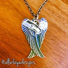 Blue to green ombre patina wings and Seattle Seahawks logo with Rhinestone charm necklace