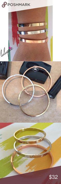"3 Tone ""Love"" Bangle Bracelets 3 Tone ""Love"" Bangle bracelets. Each set comes with 1 gold, 1 silver and 1 rose gold bracelet. Fits writs up to 8"" Bchic Jewelry Bracelets"