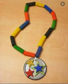 Juice Can Lid Olympic Medals - DolledUpDesign The Effective Pictures We Offer You About summer Olymp Olympic Games For Kids, Olympic Idea, Greek Myths For Kids, Olympic Crafts, Can Lids, Tie Dye Crafts, Olympic Medals, Sport Craft, Cool Art Projects
