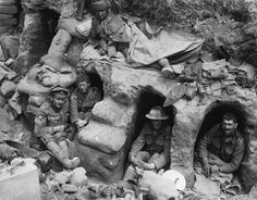 Men of the Border Regiment resting, some in funk holes, in a front line trench…