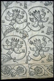 A rare woman's skirt made from fustian, a mix of linen and cotton, and embroidered with large floral patterns. Production Date: 1621-1640 ID no: 59.77b Museum of London
