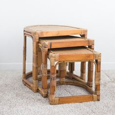 Winslet Nesting Tables: Winslet is a unique man due to his half-circle shape. A set of masculine rattan nesting tables, he provides guests with plenty of room for resting their drinks, or you can place blooms on each of his levels. *Measurements provided are for the largest table.