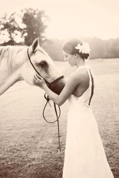 Rustic bridal portrait with white horse in black and white; Mississippi Wedding