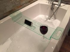 Relax in the bath with our wine glass holder – perfect after a stressful day!  Perfect for a Christmas, birthday or housewarming gift  Laser engraved by ourselves with beautiful engraved logo  Holds one wine glass  Slot for smart phone/tablet  Fits most standard baths Engraved wording Made from green edge acrylic  This item, if purchased by international customers will be sent by tracked mail so that its whereabouts is known at all times. This will avoid the disappointment of lost parce...