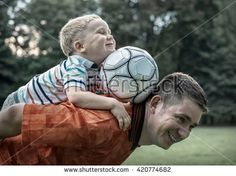 stock-photo-father-and-son-playing-football-in-park-at-sunny-day-420774682.jpg (450×337)