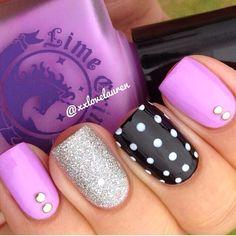 Purple, black, and polka dot nails.